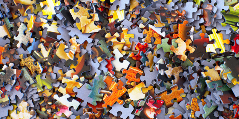 Jigsaw pieces scattered symbolising mediation