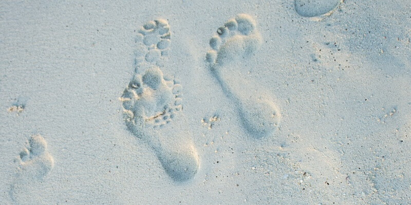 Footprints and Shoe-prints in the Sand