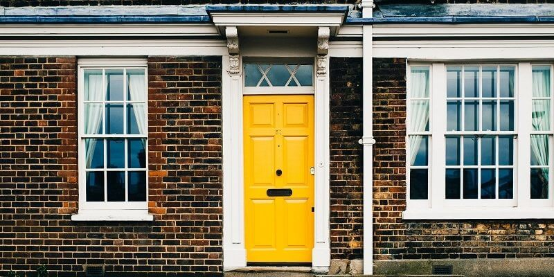 Yellow door of Brick Property