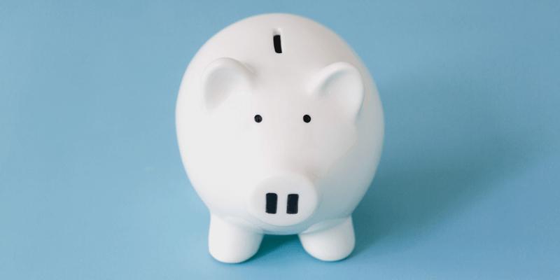 Ceramic White Piggy Bank on Blue Background