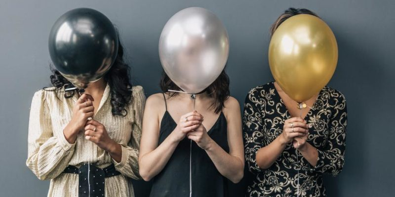 Party girls holding balloons