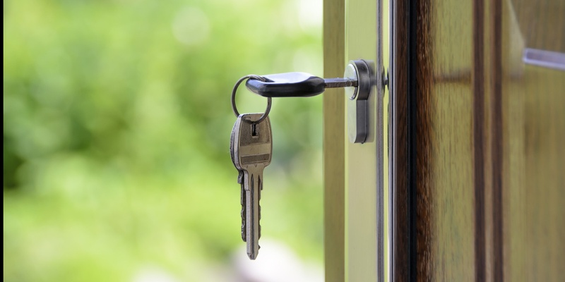 Keys in a door signifying property purchase